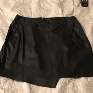 Prettylittlething black leather skirt worn only on